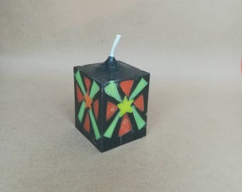 Cube candle with starburst motif inlay