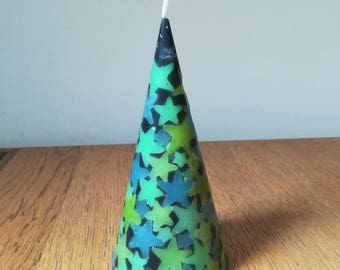 Black cone candle with fluorescent stars scented bubblegum