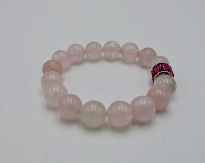Natural heart healing rose quartz beaded stretch bracelet 10mm beads, Swarovski Elements pink crystal charm bead. Be Charmed from Swarovski