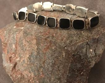 "Vintage ""950"" silver and onyx hinged bracelet"