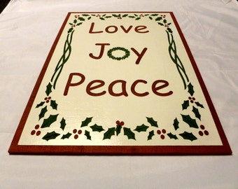 Christmas Love Joy Peace 17 1/2 X 11 1/2 laser engraved, hand painted decorated with holly and berries sign. Christmas decor, xmas decor