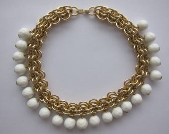 RAS of the 50's in white glass and gold metal neck. Rare model.