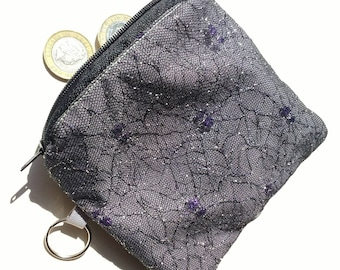 Sparkly spiderweb zipped flat purse