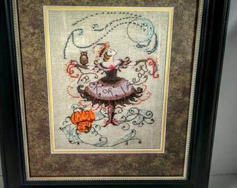 Halloween Fairy design by Nora Corbett, finished cross stitch, framed