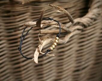 Sliding plate slide bracelet gold