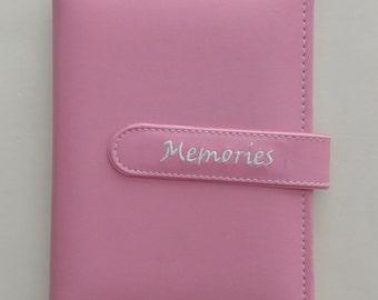 Pink leather scrapbook album