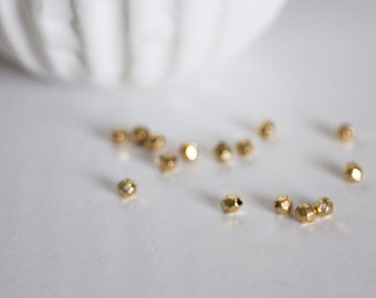 Set of 50 faceted Golden Tibetan silver spacer beads