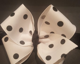 Black and white polka bow.