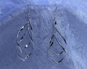 Trendy ornament earrings silver.