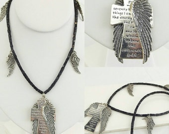 Black beaded necklace with wings and crosses