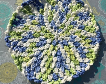 Round blue, green and white washcloth