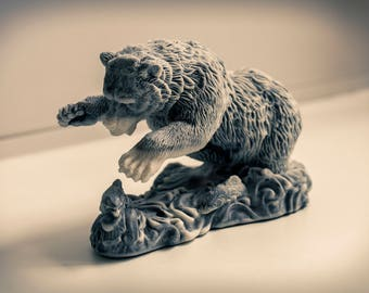 Figurine of a bear catching a fish