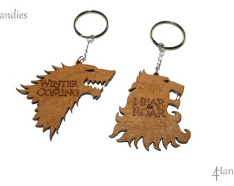 Game of thrones keychains. Winter is coming, Hear me roar. Stark and Lannisters shield.