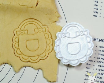 Bib with Pocket Cookie Cutter and Stamp Set