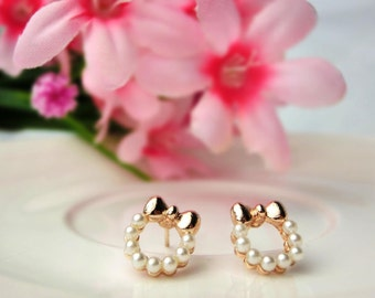 Stud Earrings - rose gold ribbon with pearl ring