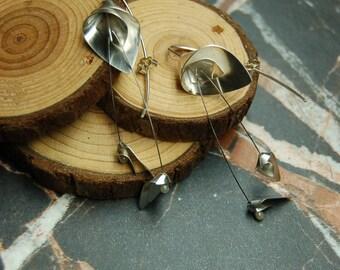 Silver 'Flourish' dangly earrings