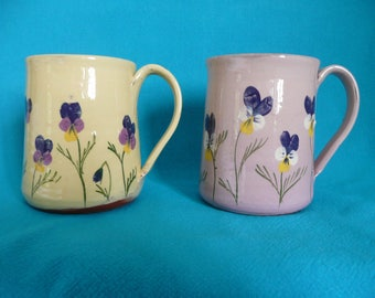 Handmade pottery mug Viola mugs in pale yellow and lilac with an apple green interior