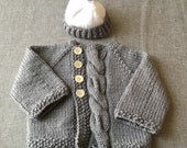 Cabled baby cardigan with matching beanie. Size 3-6 months