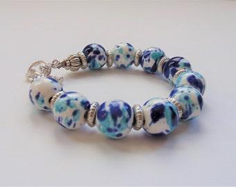Handmade ceramic white and blue bracelet