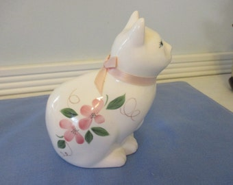 Adorable vintage ceramic cat with pink neck ribbon