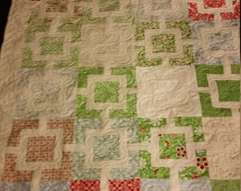 Twin sized geometric green, blue and red quilt