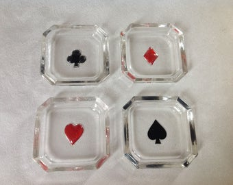 A set of four glass card suit dishes