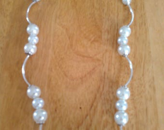 Artistic pearl and silver necklace