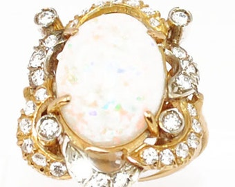 Ring gold yellow 18K adorned with an Opal
