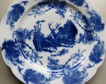 Awesome vintage large charger/ decorative blue and white plate featuring deer and forest.