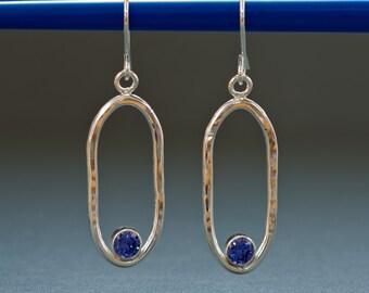 Sterling Silver oval hoop earrings with purple crystal