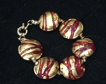 Red and gold textured handmade bracelet
