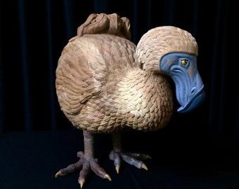 A Wooden, Hand-Carved Extinct Dodo Sculpture