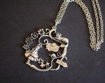 Silver tone Alice in wonderland garden scene necklace