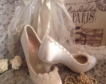 Ivory satin hearts and roses bridal shoes