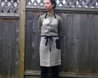 linen apron with a pentagon-shaped black pocket