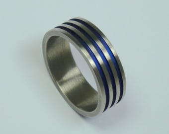 Titanium ring, blue anodized titanium ring blue grooves.