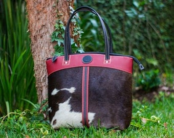 Cowhide Leather handbag with red-brown colors.