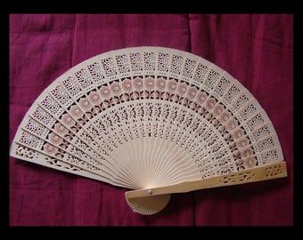 Vintage carved wooden fan
