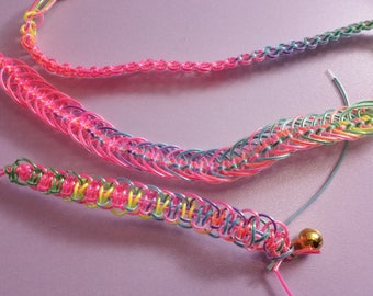 Wristbands and key rings of friendship with colored wires
