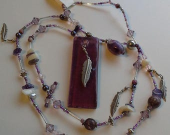 Long purple beaded feather necklace
