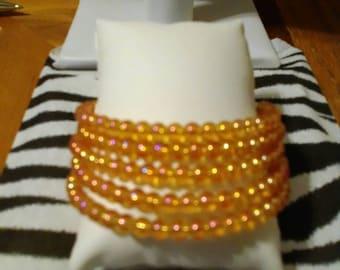 Rose gold electroplated color change glass coil wrap bracelet
