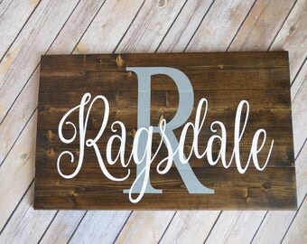 Last Name & Initial wooden sign