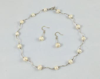 Pearl and sterling silver matching necklace and earring set