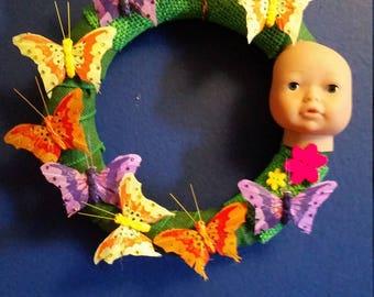 Doll head butterfly wreath weird decor