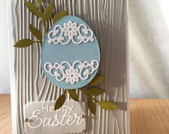 Easter Card - Blue Lacy Egg and Greenery on Woodgrain Background