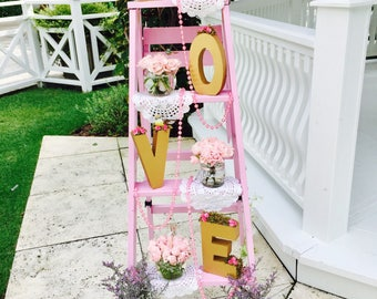 """Gold color letters with vintage look with the message of """"LOVE"""""""