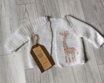 Crocheted baby cardigan with giraffe applique