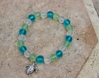 Blue and green sea glass stretch bracelet with detailed turtle charm
