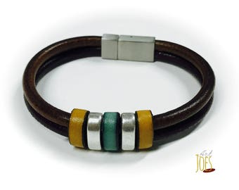 Two Brown and central motive leather bracelet