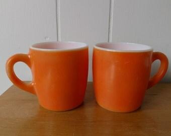 2 vintage orange milk glass mugs